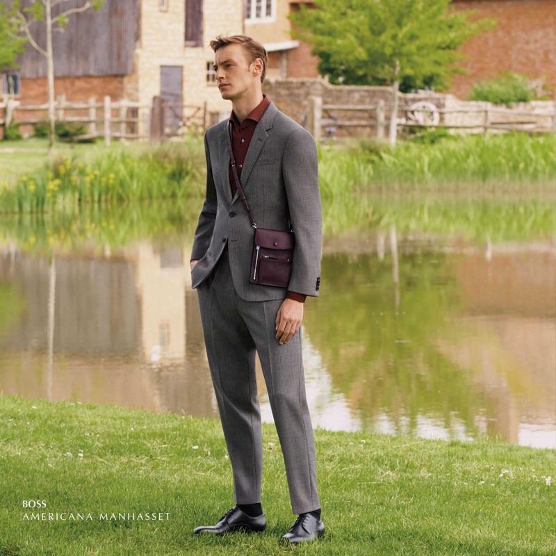 Donning a sleek grey suit, Roberto Sipos wears BOSS.