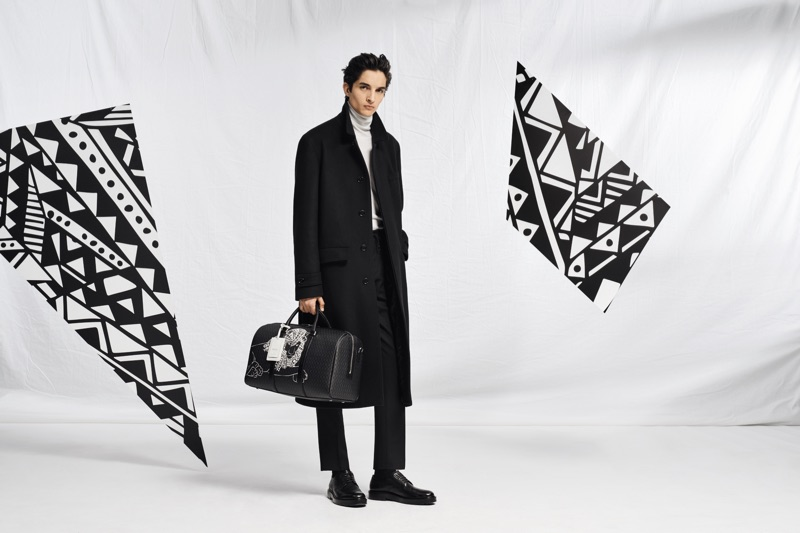 Pablo Fernandez takes hold of a leather carryall from the BOSS x Meissen holiday 2019 capsule collection.