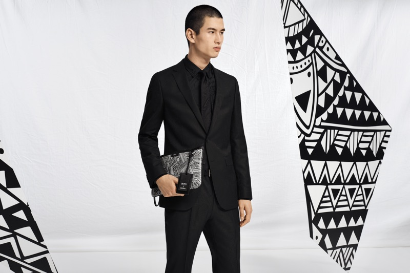 Kohei Takabatake holds a leather portfolio from the BOSS x Meissen holiday 2019 capsule collection.