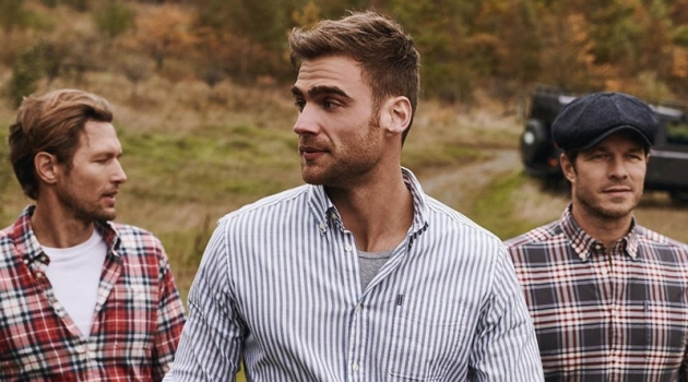 Robertas Aukstuolis, George Alsford, and Paul Sculfor wear tops from Barbour's fall 2019 Shirt Department collection.