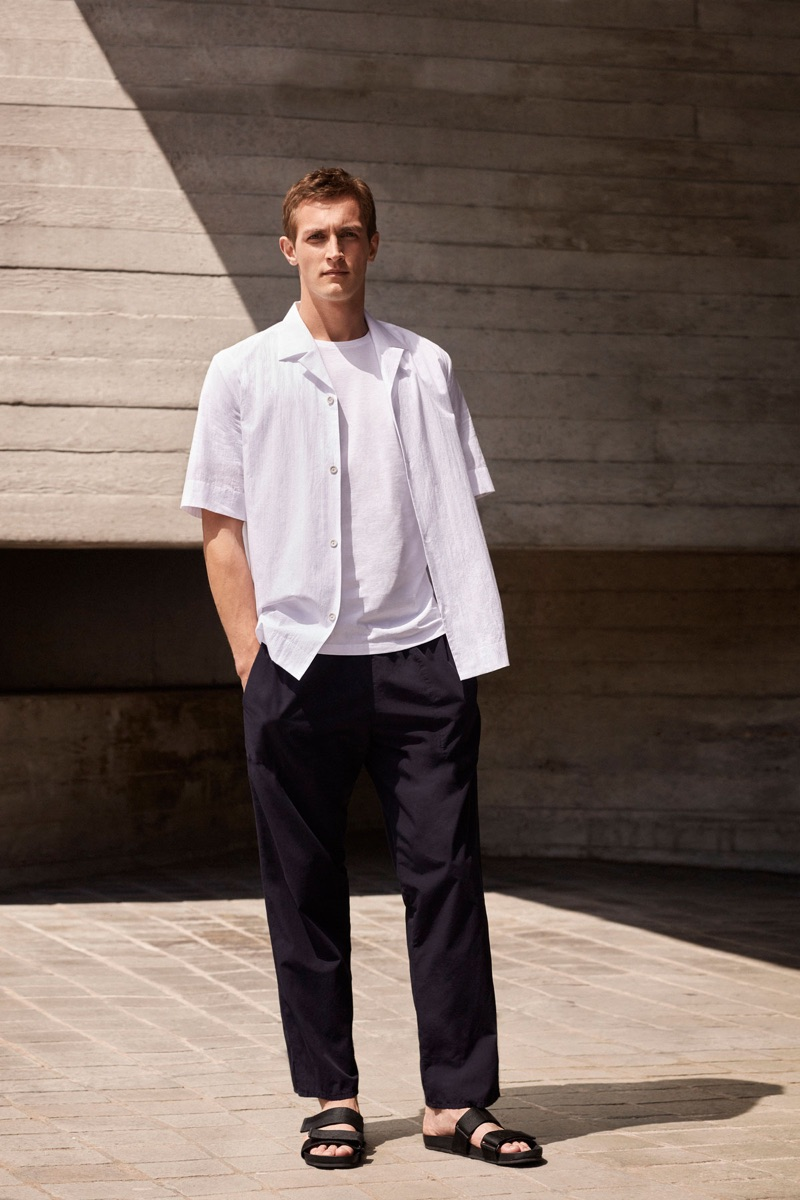 Rutger Schoone dons a white and black outfit from COS.