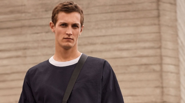 Committing to a black and white look, Rutger Schoone rocks an oversized tee from COS.