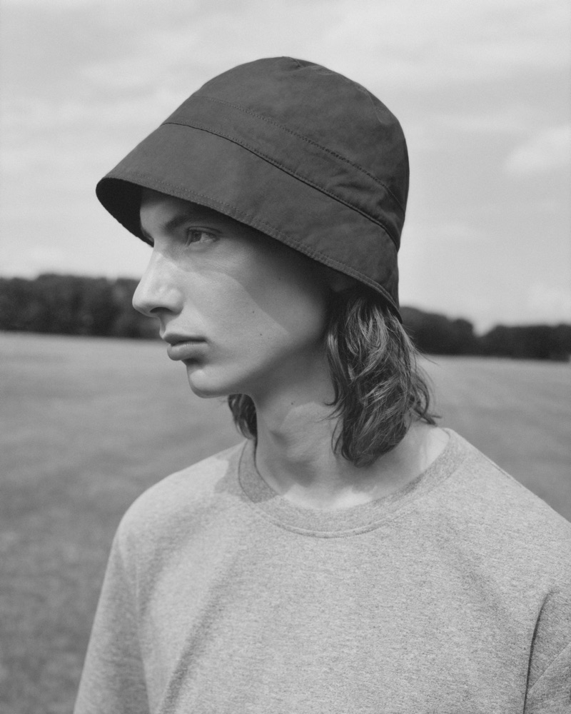 Casper Plantinga wears a bucket hat and top from COS.