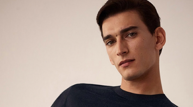 Thibaud Charon dons a fine merino sweater from COS.