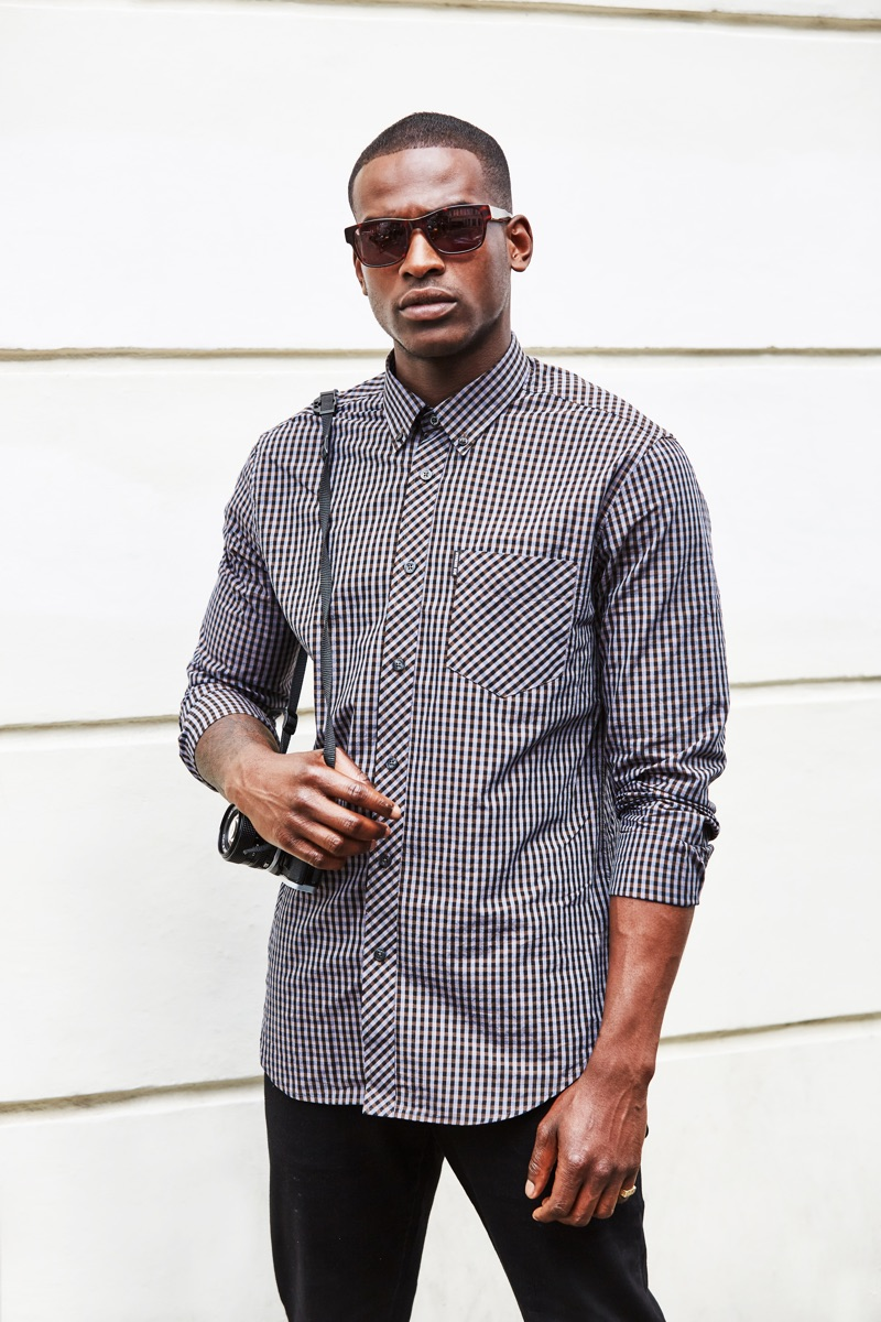 Photographer, DJ, and model Chris Reid goes casual in Ben Sherman.
