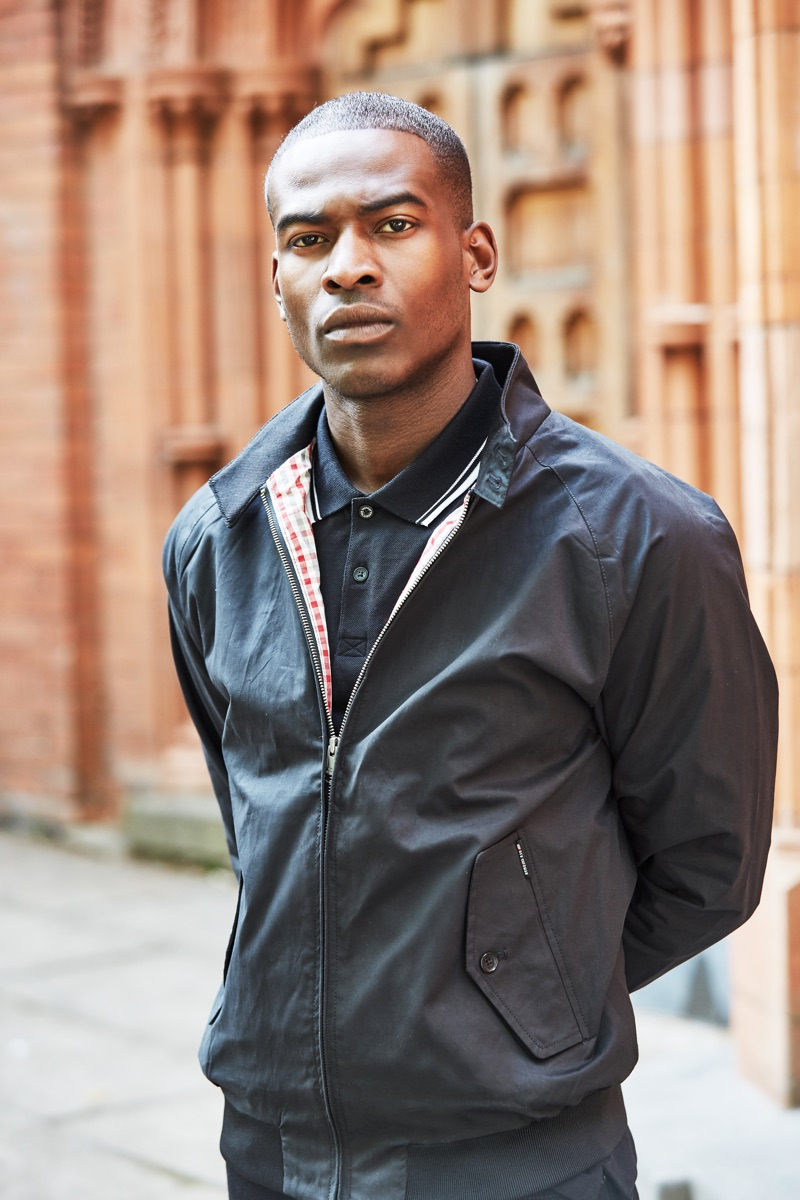 Chris Reid wears a Harrington jacket and polo by Ben Sherman.