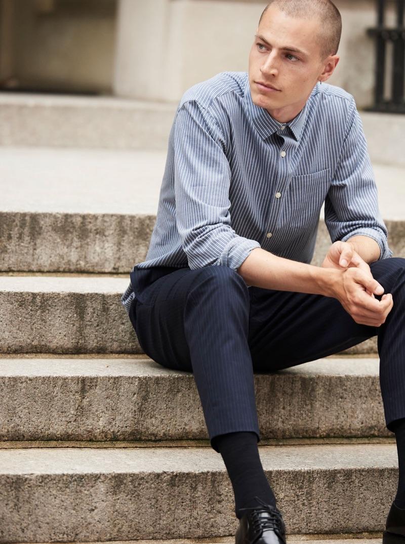 A smart vision, Jonas Kloch models a Club Monaco knit stripe shirt $119.50 with elasticated pinstripe pants $159.50.