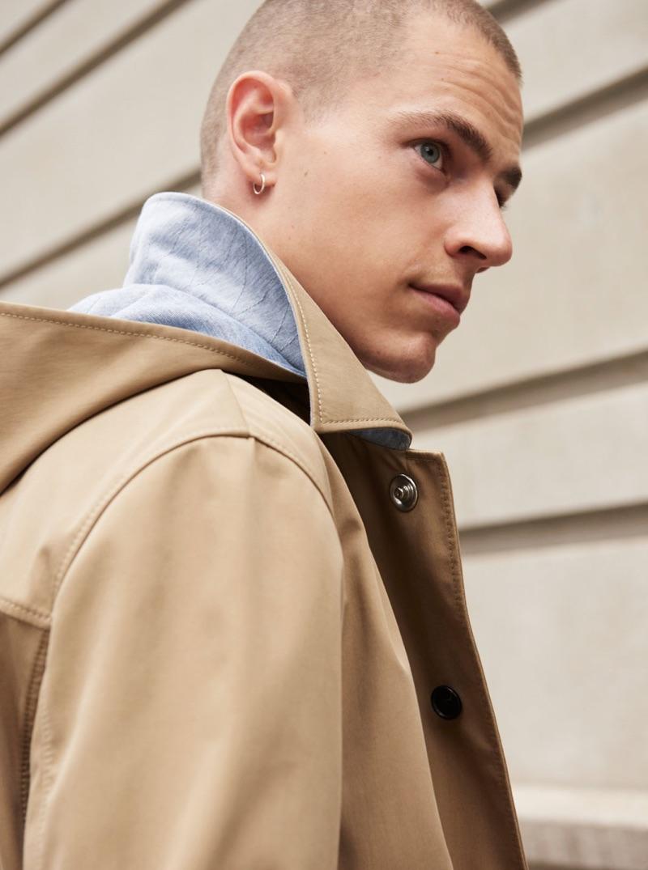 Connecting with Club Monaco, Jonas Kloch wears the brand's khaki mac coat $329.