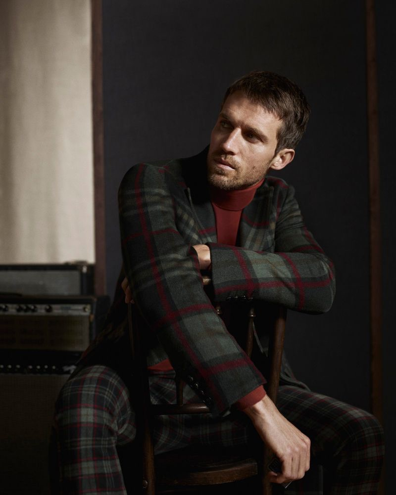 Donning tartan, Andrew Cooper appears in Daks' fall-winter 2019 campaign.
