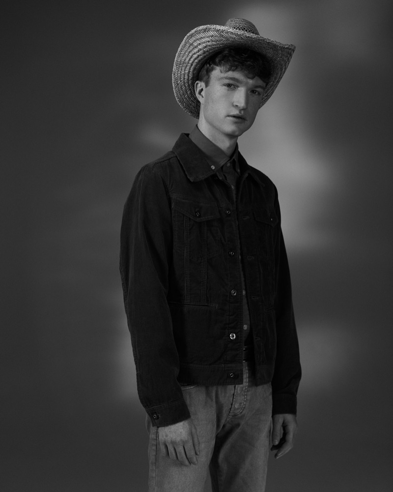 Julien wears hat Crystal Birch, jacket, shirt, and jeans G-Star Raw.