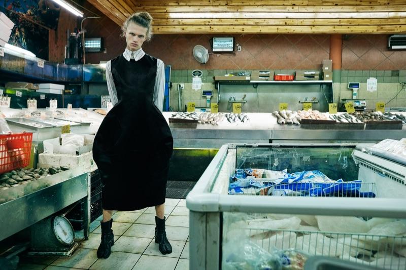 Finlay wears shirt Vivienne Westwood, dress Comme des Garçons, and boots Maison Margiela.