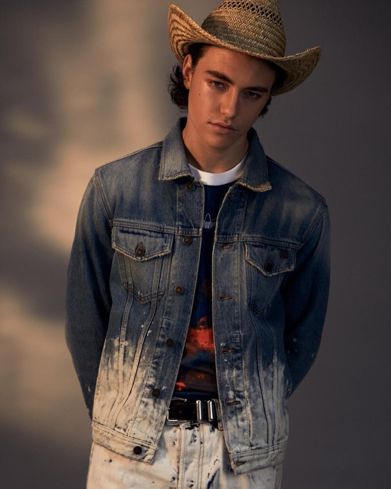 Jan wears t-shirt Adidas Originals, hat Crystal Birch, jacket and jeans Diesel.