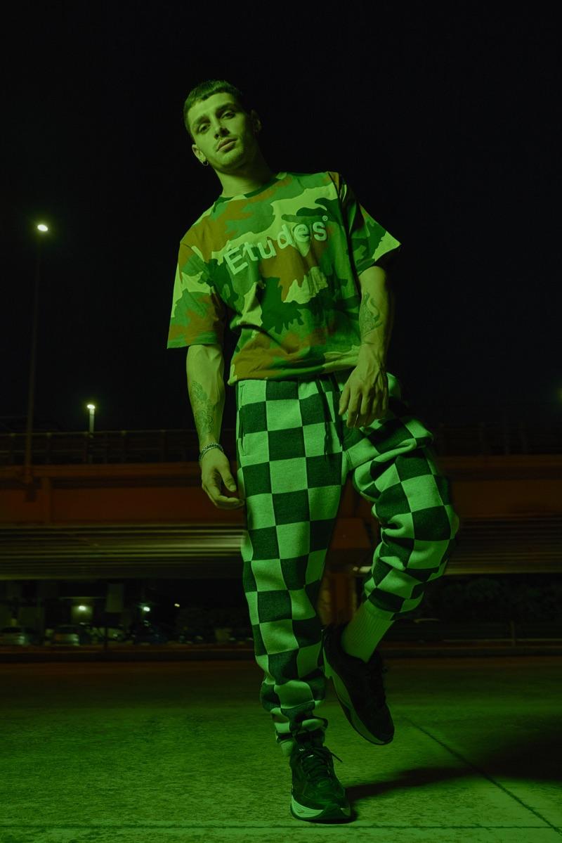 Nicolò wears t-shirt Études, pants Vans, and shoes Nike.