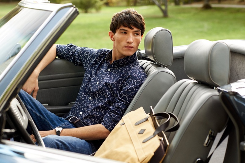 Ready for a weekend getaway, Jester White wears a patterned shirt and jeans from GANT.