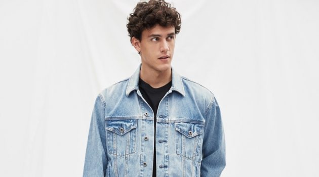 Xavier Serrano wears Gap's '90s Originals oversized Icon denim jacket $98 and easy fit jeans $69.95.