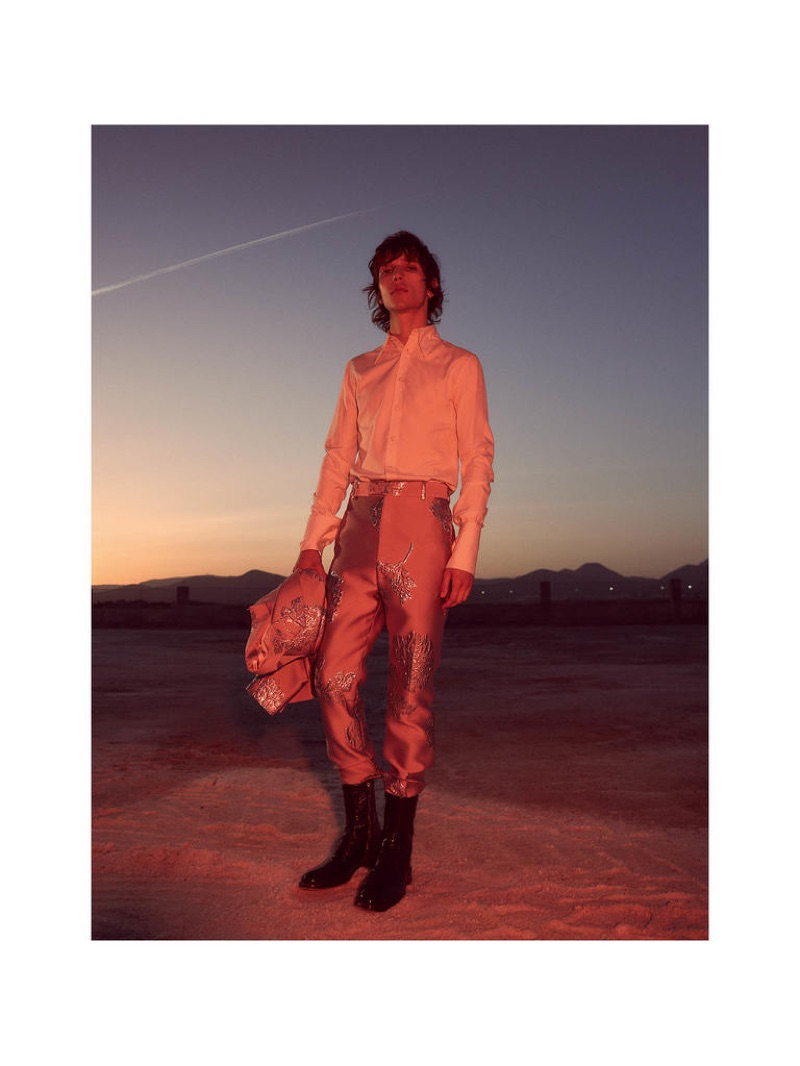 Eliseu wears ALEXANDER McQUEEN shirt from a selection, trousers £620 and jacket £1,995; GIVENCHY boots from a selection