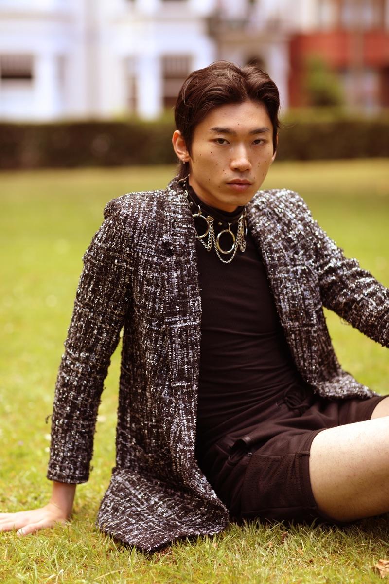 Hidetatsu wears choker Kali Theaa, top Hugo Boss, shorts Prada, and blazer Topman.
