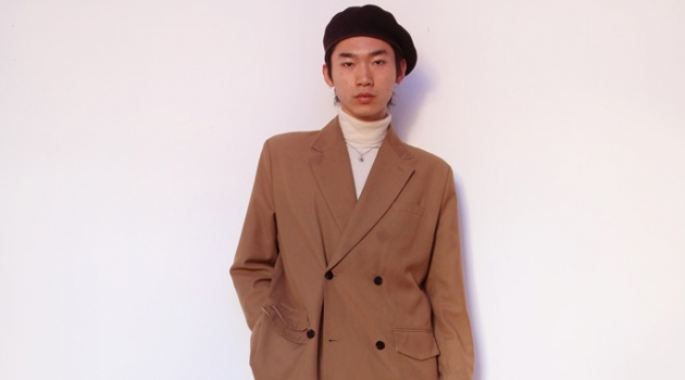 Hidetatsu wears beret SCHA, suit jacket Gentle x Cover, turtleneck Calvin Klein, necklace XU Harajuku, jeans MISBHV, and boots Dries Van Noten.