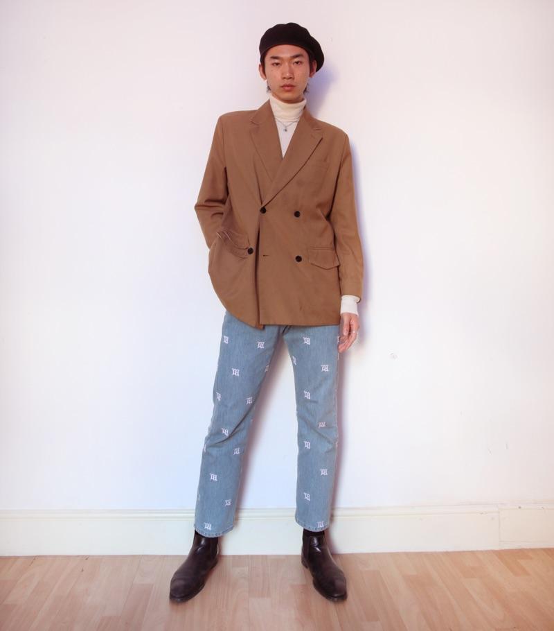 Hidetatsu wears beret SCHA, suit jacket Gentle x Cover, turtleneck Calvin Klein, necklace XU Harajuku, jeans MISBHV, and boots Dries Van Noten.