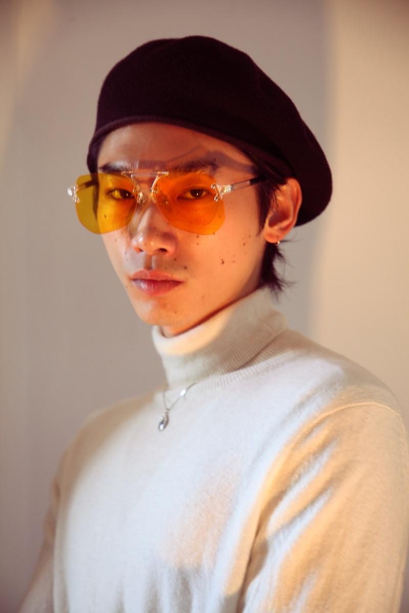 Hidetatsu wears beret SCHA, sunglasses PRTTYBOI, turtleneck Calvin Klein, and necklace XU Harajuku.