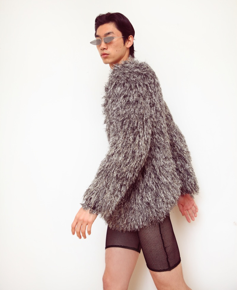 Hidetatsu wears sunglasses Gentle Monster, sweater ASOS Design, and shorts Revolve.