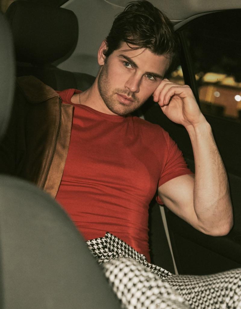 Ian wears suede jacket Ralph Lauren, shirt Acne Studios, and houndstooth pants Dsquared2.