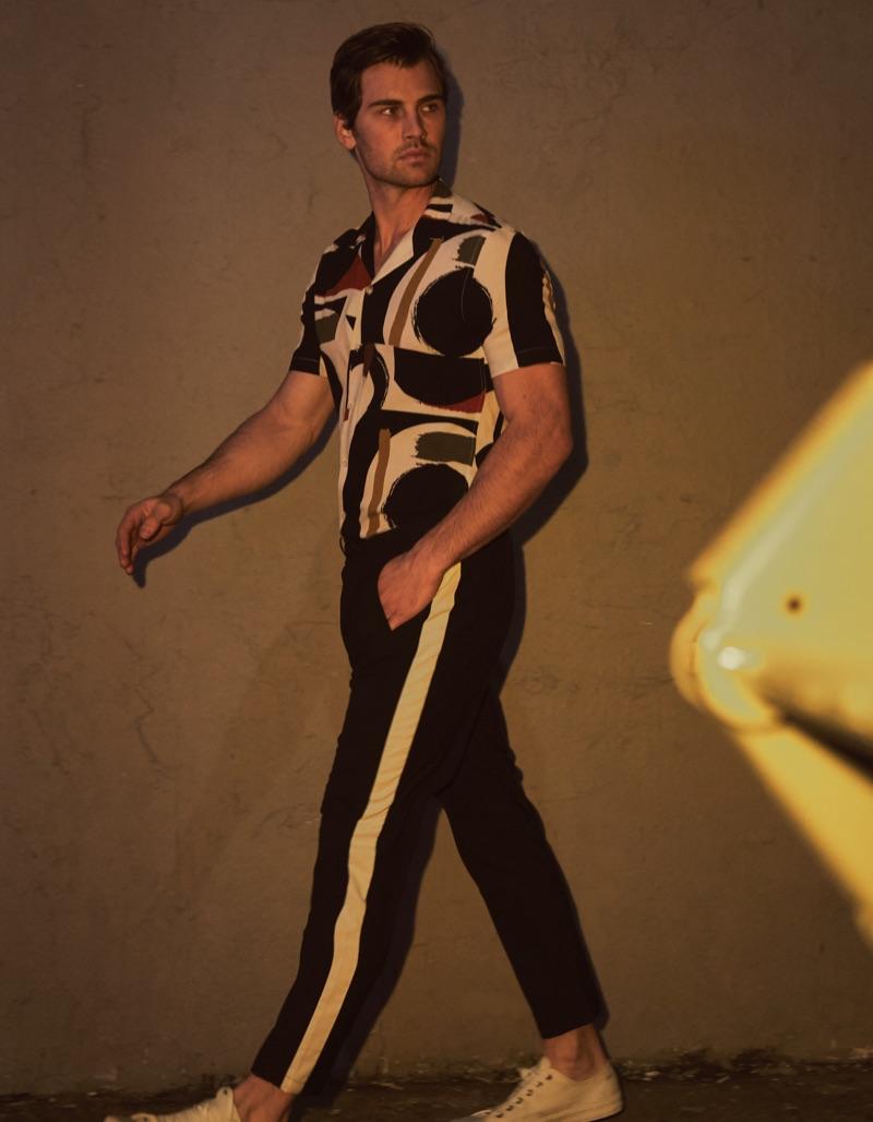 Ian wears shirt stylist's own and pants Neil Barrett.