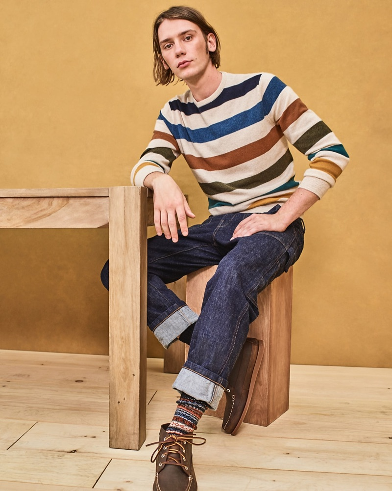Making a case for color, Luca Bertea wears a J.Crew striped sweater $128, Wallace & Barnes carpenter jeans in Japanese rinsed indigo denim $148.