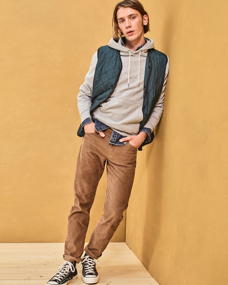 Front and center, Luca Bertea sports a J.Crew denim shirt $79.50, quilted vest $128, hoodie, 770 corduroy pants $79.50, and Converse Chuck Taylor All Star '70 high-top sneakers $85.