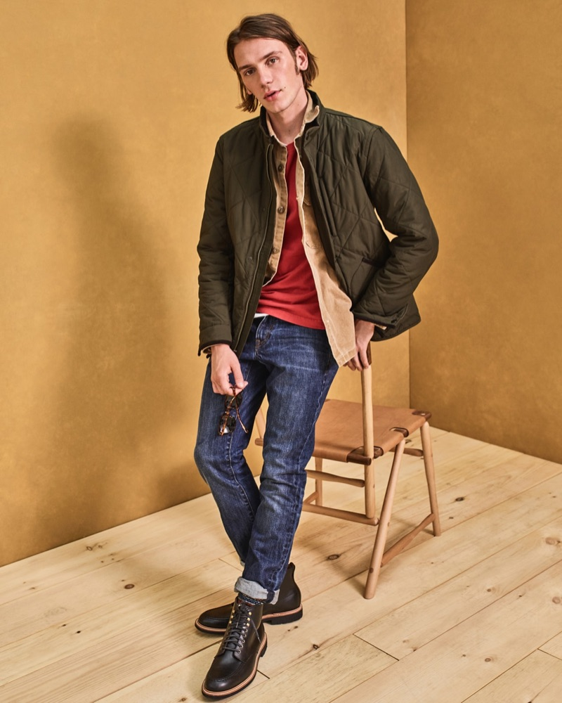Luca Bertea rocks a J.Crew quilted jacket $148, red long-sleeve t-shirt $49.50, Wallace & Barnes shirt jacket $98, and Kenton leather boots $248.