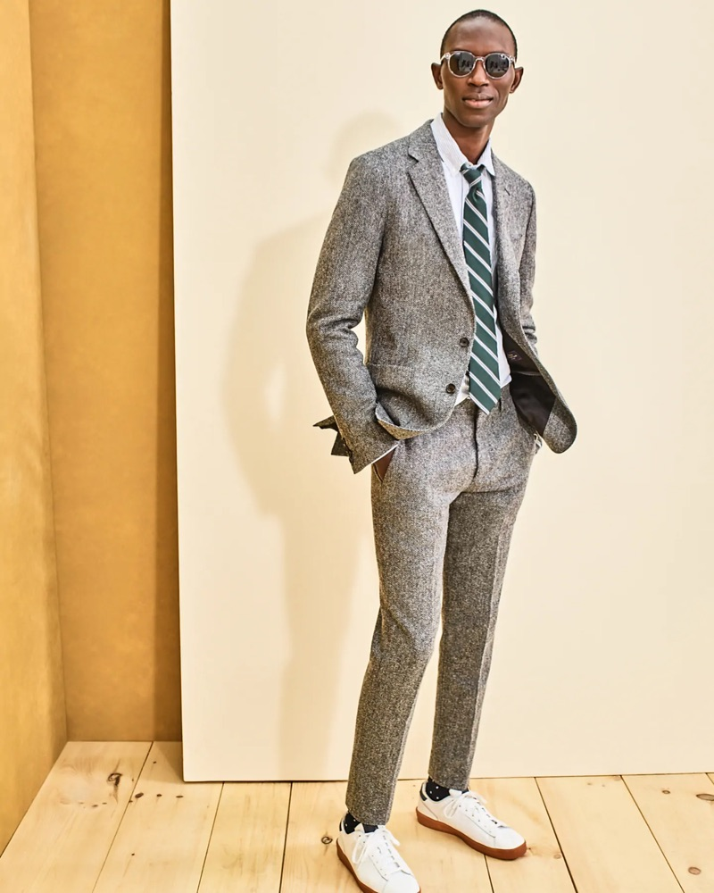 Model Armando Cabral dons a J.Crew Ludlow herringbone suit jacket $298 and pants $168 with a striped oxford shirt $69.50 and Wainscott sunglasses $59.50.
