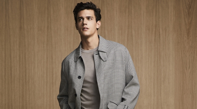 Xavier Serrano sports a chic checked coat with pleated trousers and a sweater from Liu Jo Uomo.