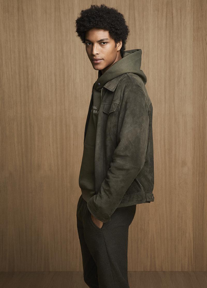 Jhonata Meneghini models a suede jacket and hoodie from Liu Jo Uomo.