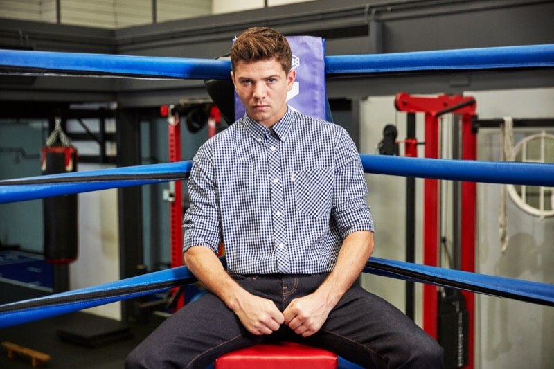 Luke Campbell rocks a checked shirt with dark rinse denim jeans by Ben Sherman.