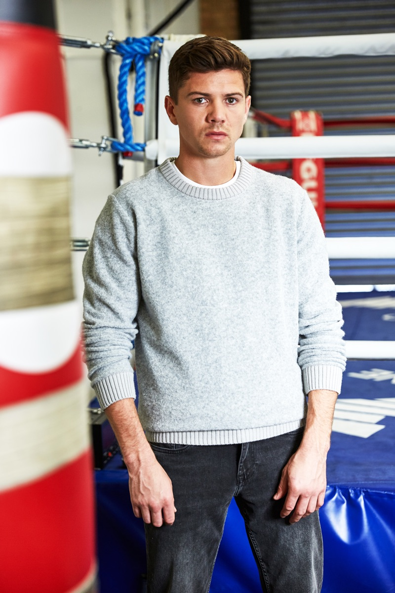 Olympic boxer Luke Campbell sports a crewneck sweater with distressed denim jeans from Ben Sherman.