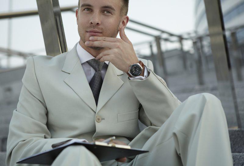 Man Neutral Suit Wearing Watch