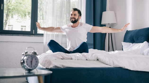 Man in Furnished Bedroom