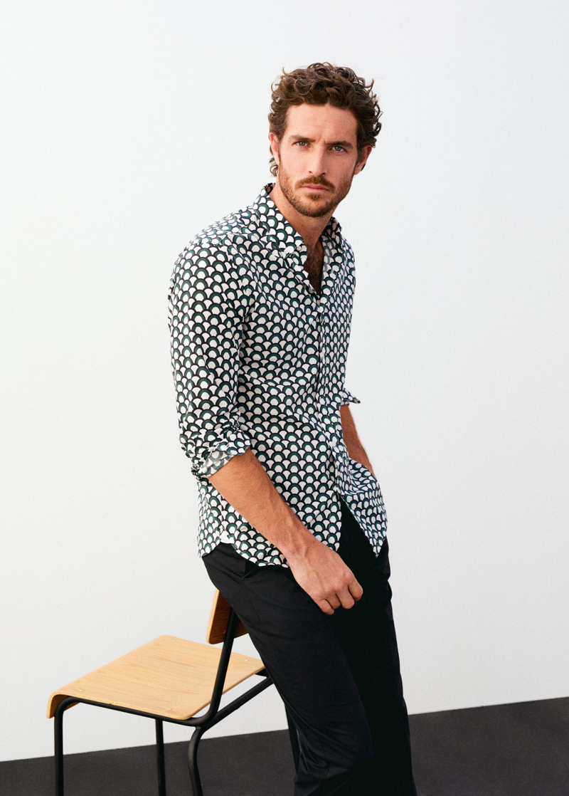Justice Joslin sports a patterned shirt with pants from Mango.