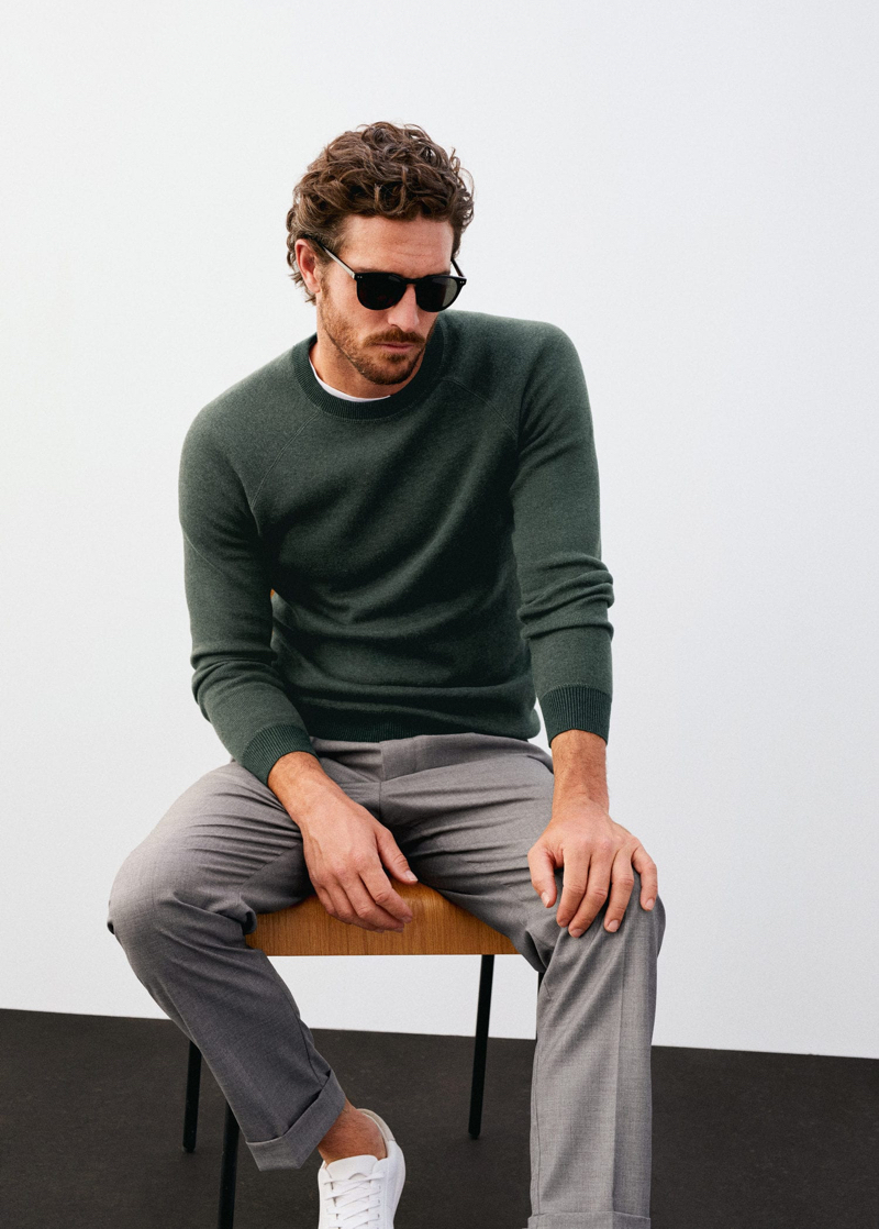 A smart vision, Justin Joslin wears a sweater with pleated trousers by Mango.
