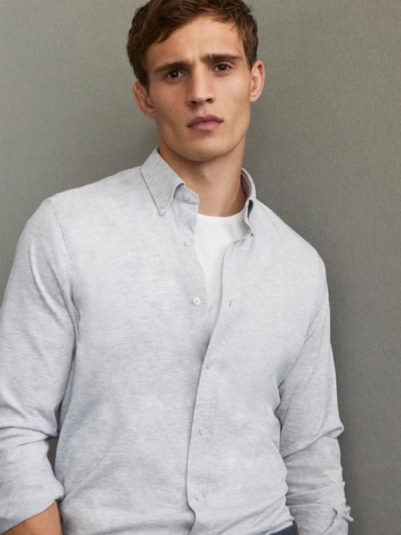 Julian Schneyder wears a smart shirt from Massimo Dutti's Travel Soft collection.