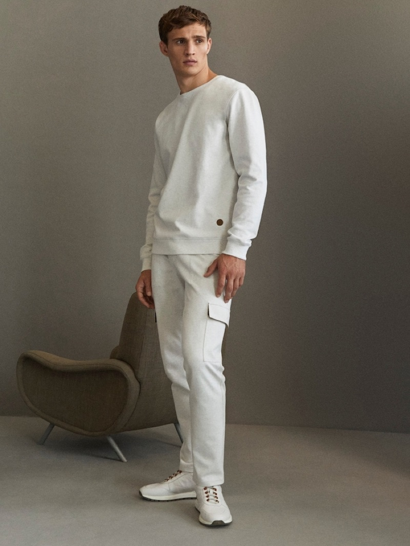 Sporting a light color scheme, Julian Schneyder wears pieces from Massimo Dutti's Travel Soft collection.
