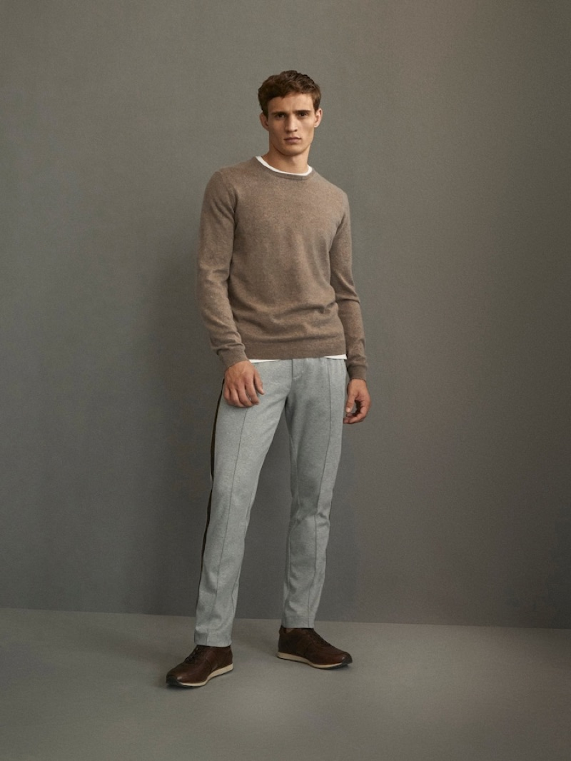 Front and center, Julian Schneyder dons an ensemble from Massimo Dutti's Travel Soft collection.