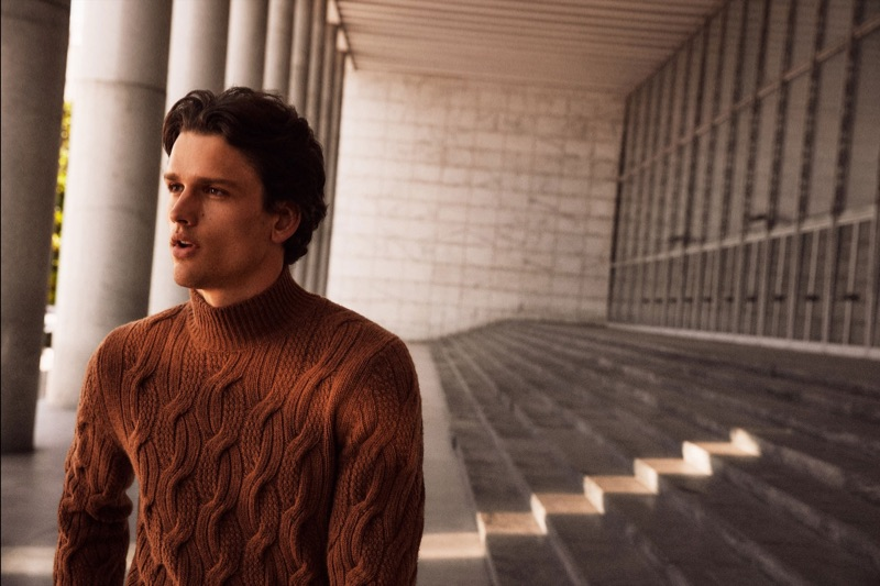 Donning a cable-knit sweater, Simon Nessman fronts Massimo Dutti's fall-winter 2019 campaign.