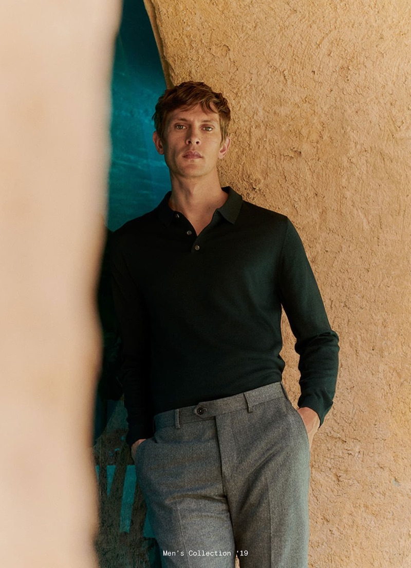 A smart vision, Mathias Lauridsen wears a long-sleeve polo and grey pleated trousers by Massimo Dutti.