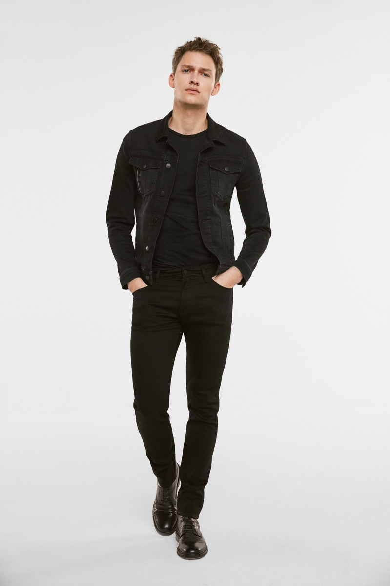 Dressed in black, Kristoffer Hougaard models Mavi's Frank denim jacket and James skinny leg jeans.