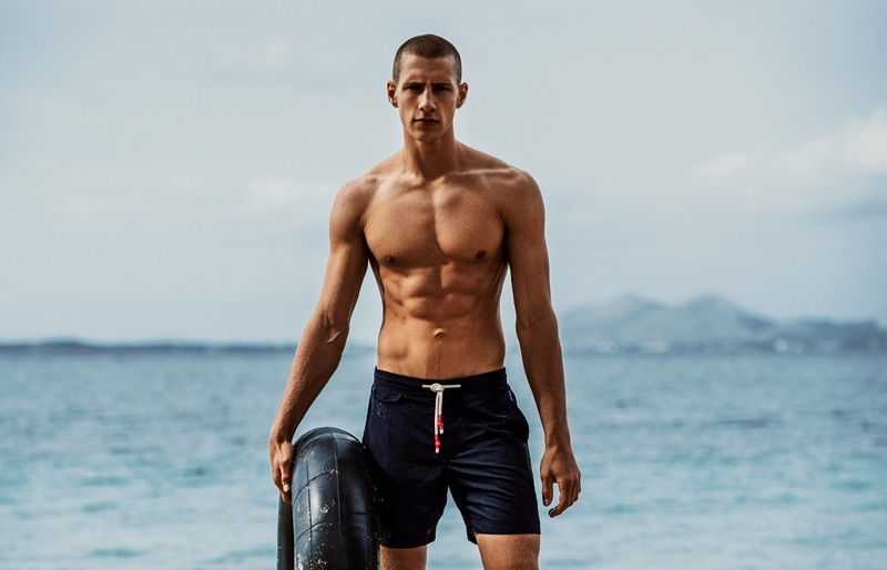 Augusta Alexander sports swim shorts from Orlebar Brown's fall-winter 2019 collection.