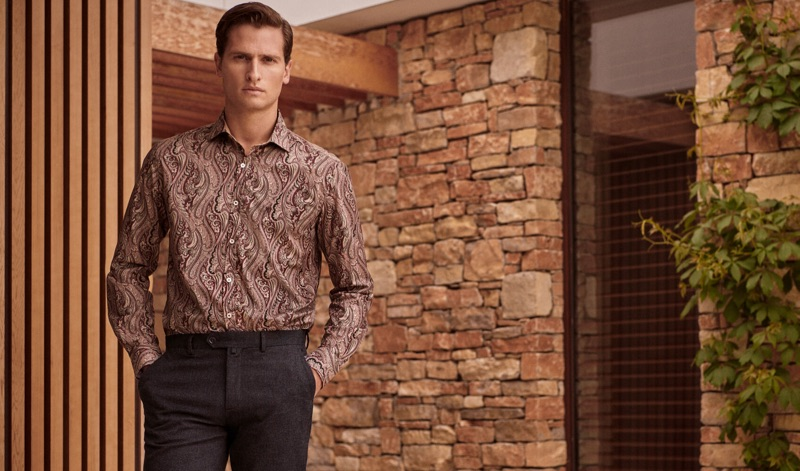 Modeling a paisley print shirt, Tom Warren appears in an image for Pedro del Hierro.