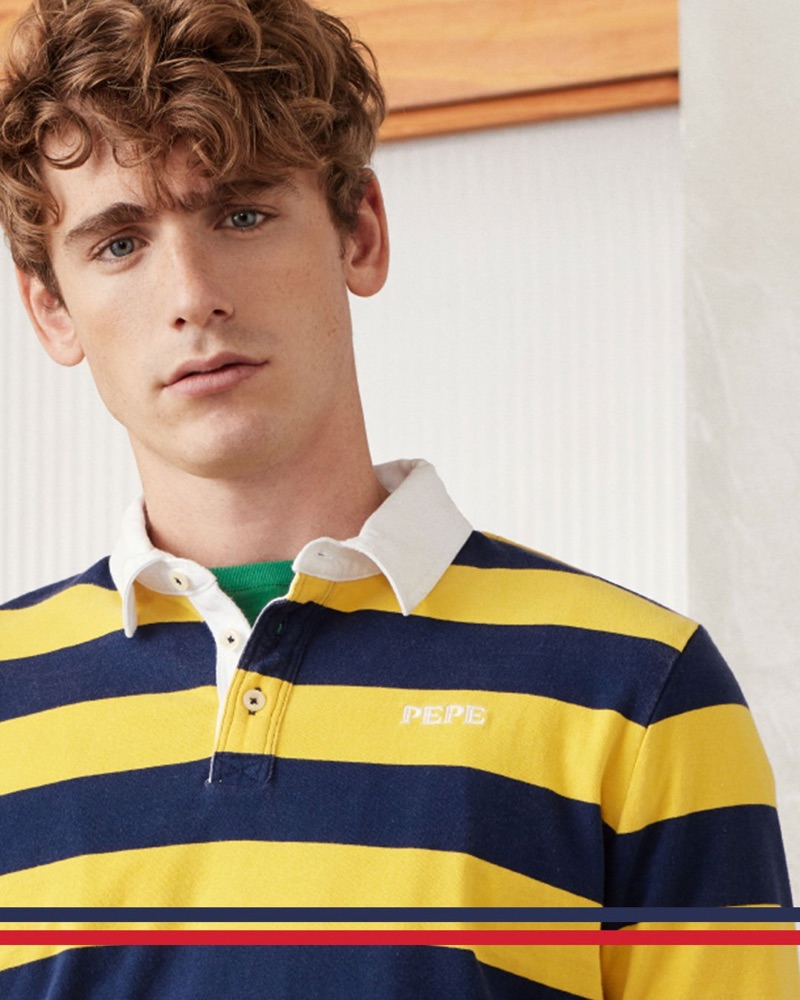 Tom Webb wears a yellow and navy striped polo from Pepe Jeans' archive-inspired Pepe collection.