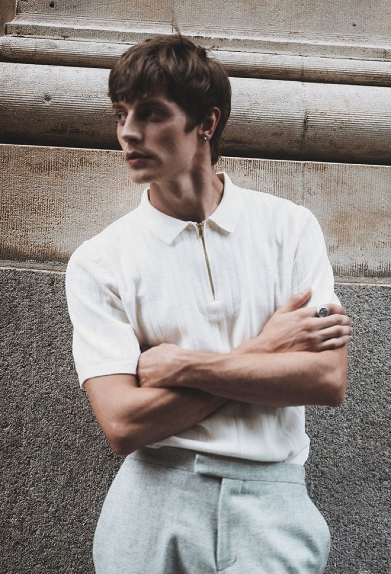 Donning a zippered polo shirt, Janis Ancens wears Reiss.