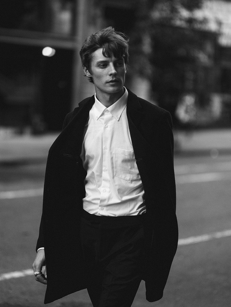Janis Ancens wears a sleek black and white look from Reiss' pre-fall 2019 collection.